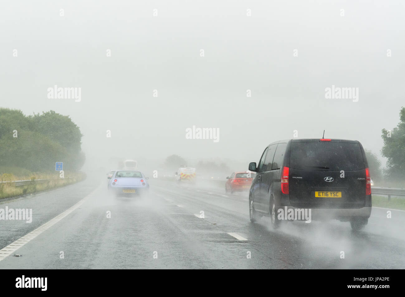 poor visibility on uk motorway due to surface water after heavy rain - Stock Image