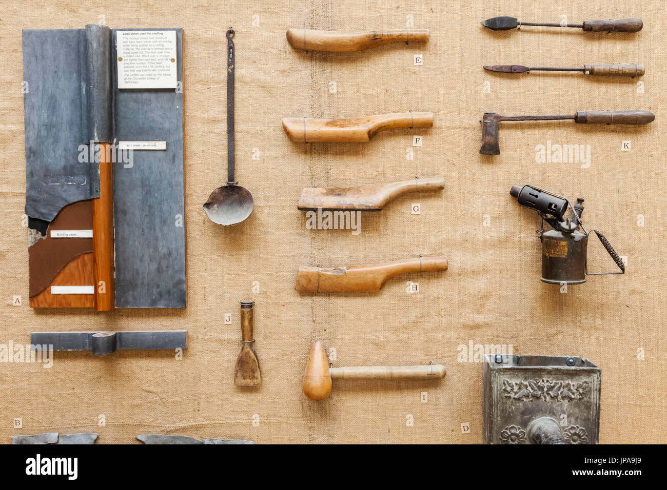 England, West Sussex, Singleton, Weald and Downland Open Air Museum, Display of Historical Plumbers Tools - Stock Image