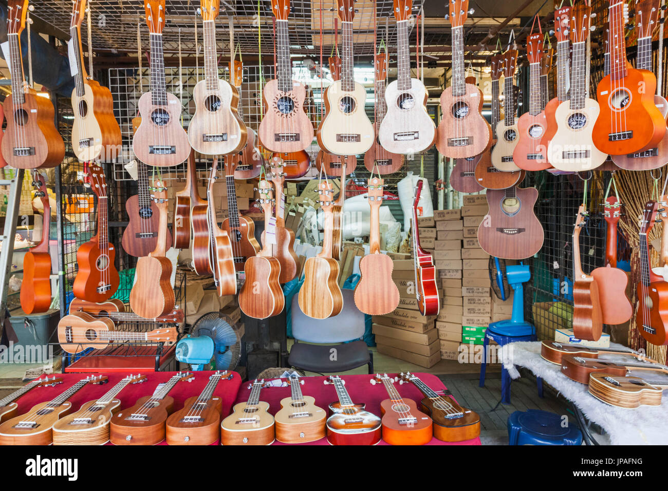 Thailand, Bangkok, Chatuchak Market, Shop Display of Ukuleles - Stock Image