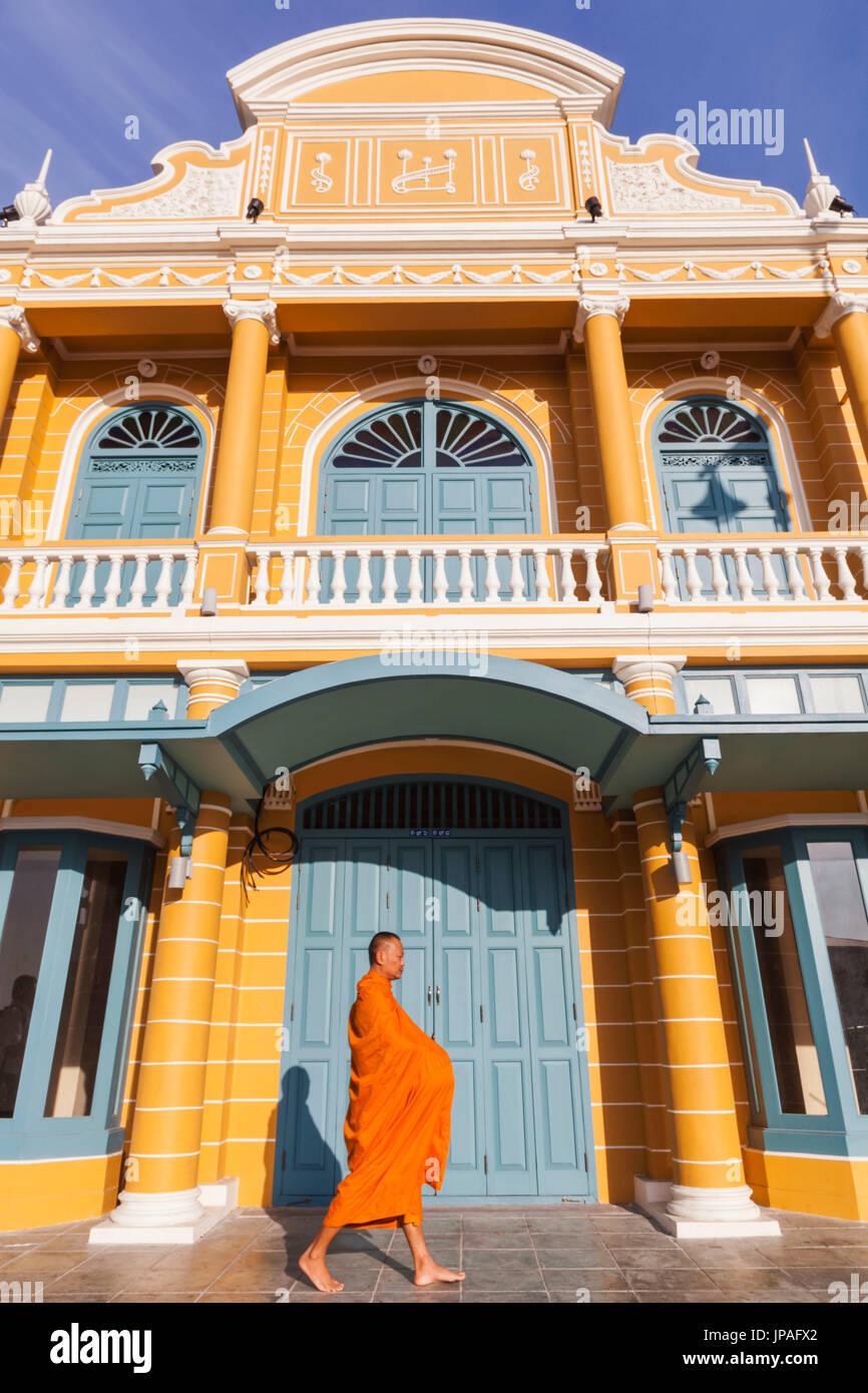 Thailand, Bangkok, Monk Walking Past Restored Traditional Shop Fronts - Stock Image