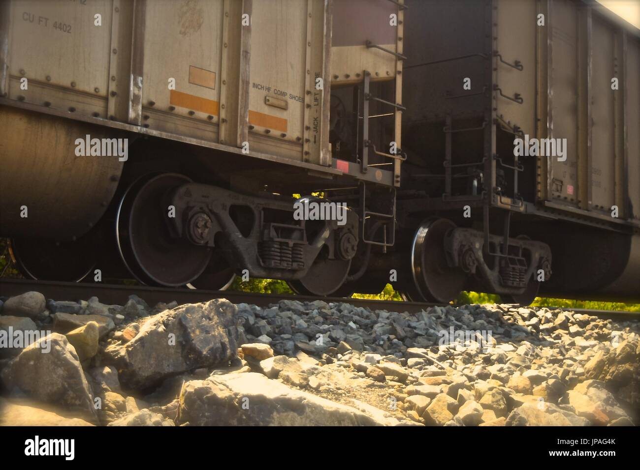 Freight train hauling and rumbling towards Seattle,. - Stock Image