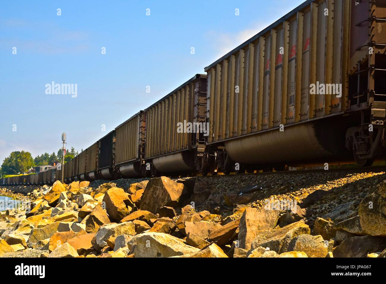 Freight train hauling and rumbling towards Seattle,. Stock Photo