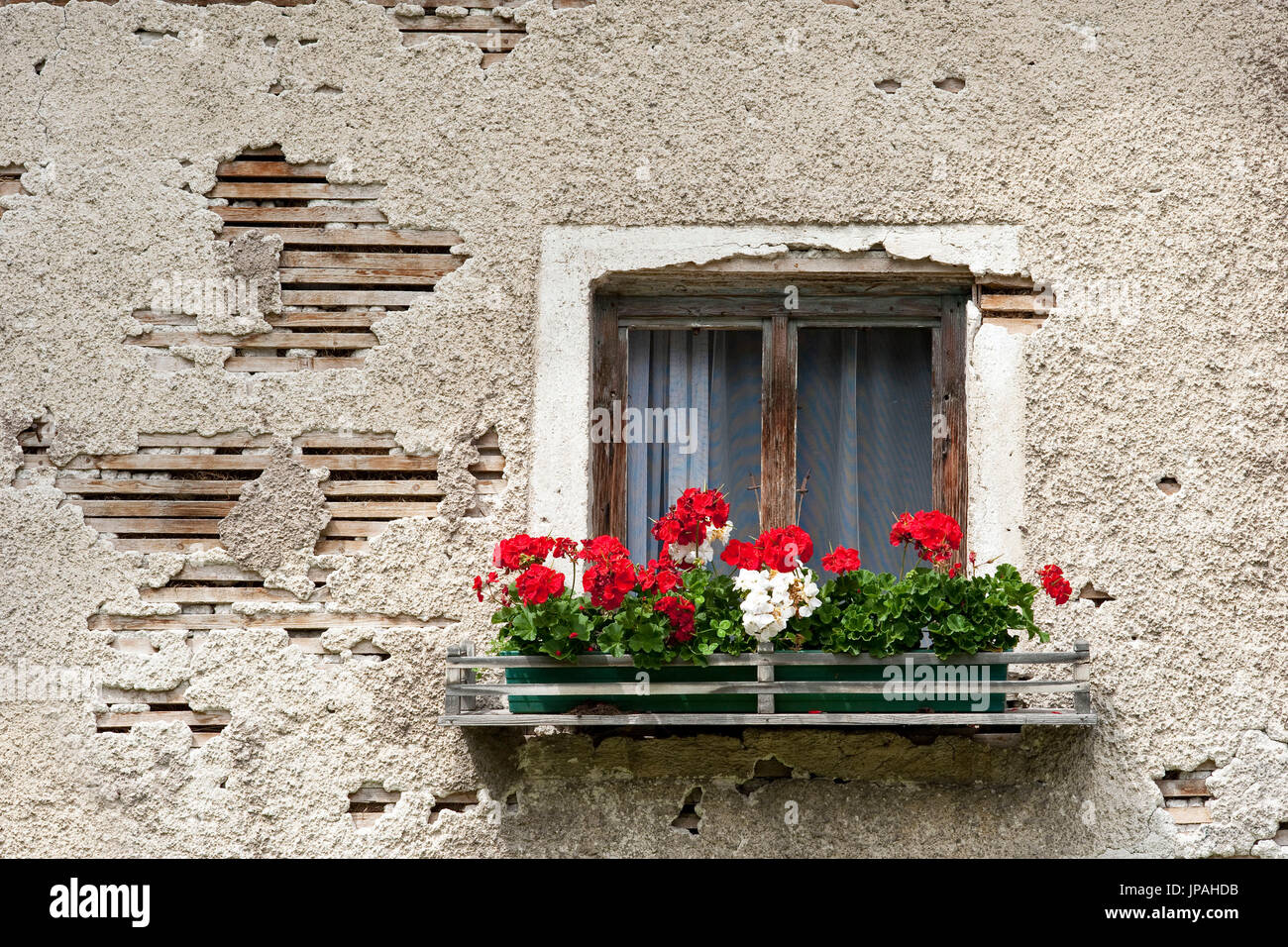 Window with window box and old broken wall. - Stock Image