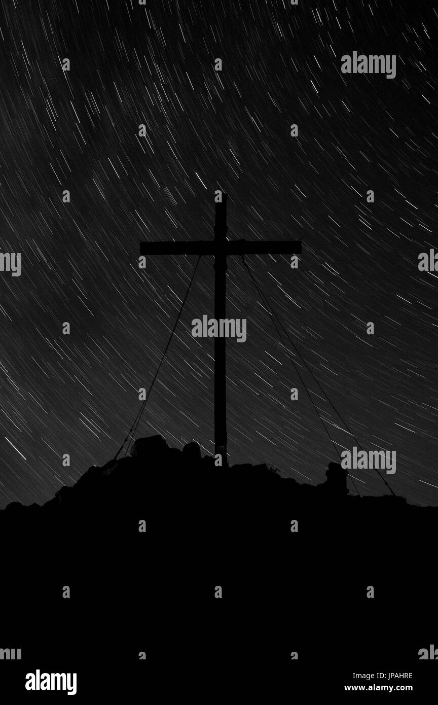 Summit cross of the Benediktenwand with stars - Stock Image