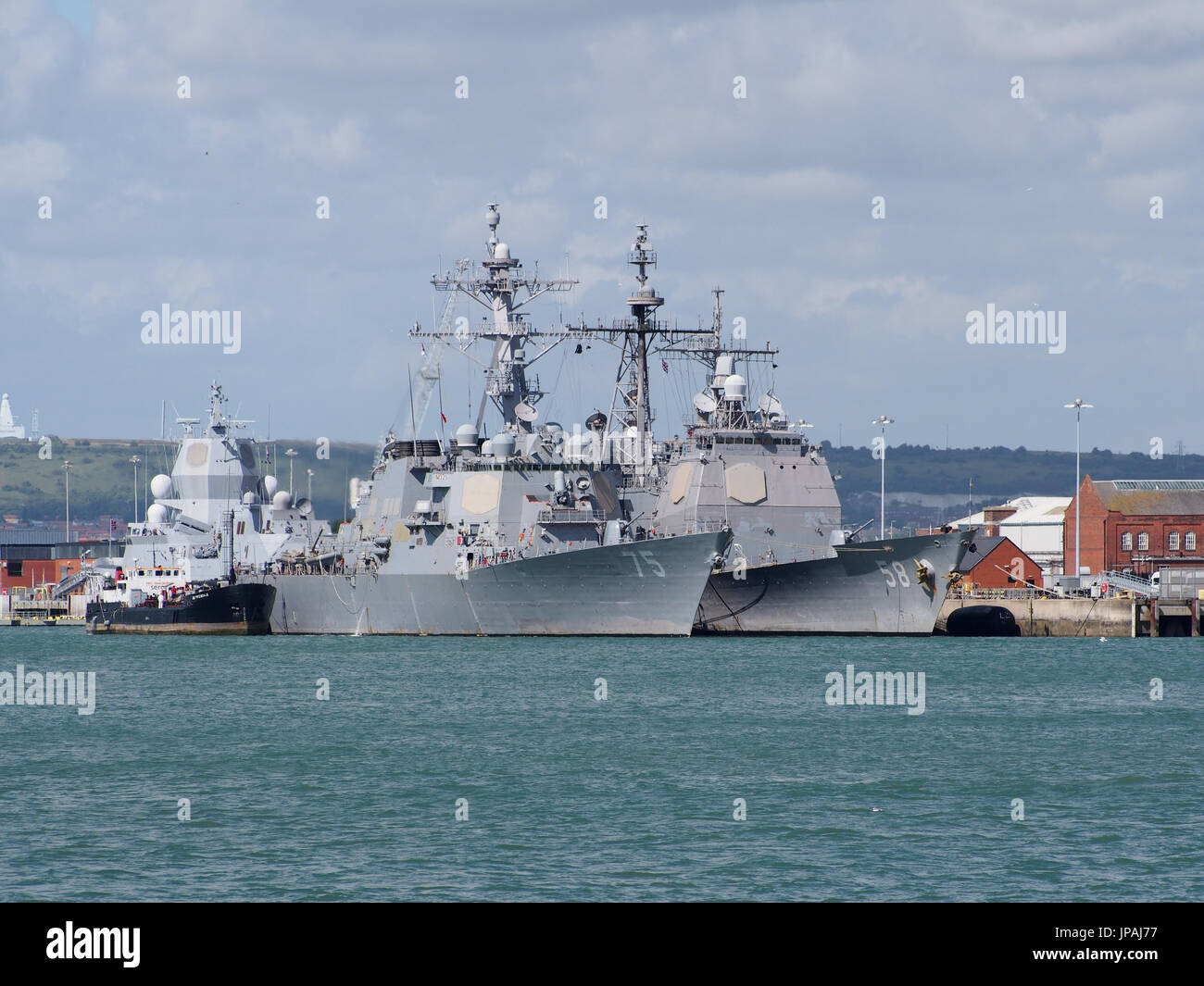 The USS Philippine Sea and the USS Donald Cook berthed together at Her Majesties Naval Base Portsmouth , England - Stock Image