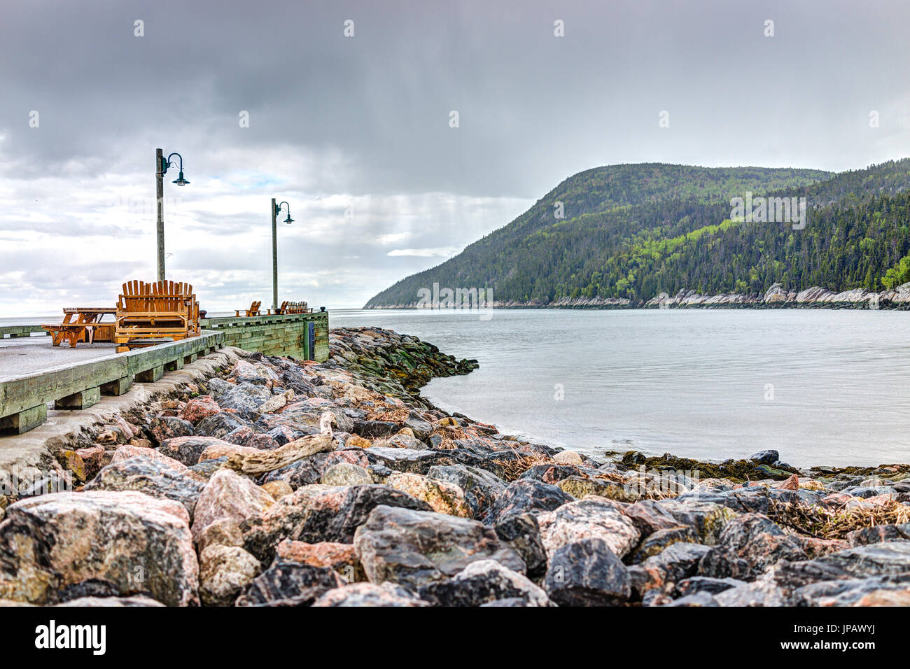 Port-au-Persil pier in Quebec, Canada Charlevoix region during stormy rainy day with Saint Lawrence river Stock Photo