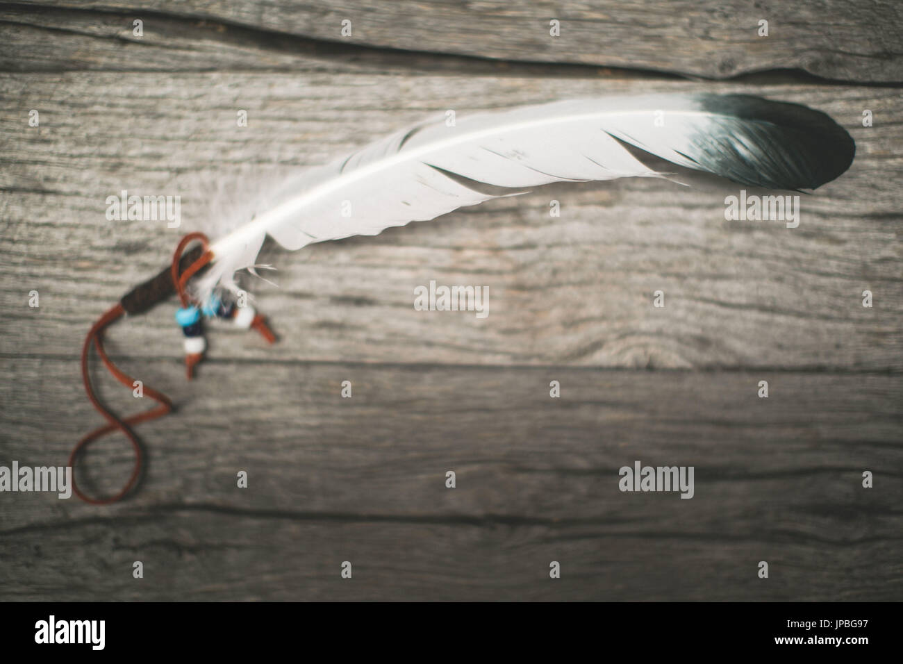 Indian feather, symbol - Stock Image