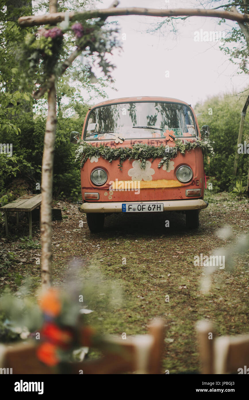 Old VW bus as a wedding car - Stock Image