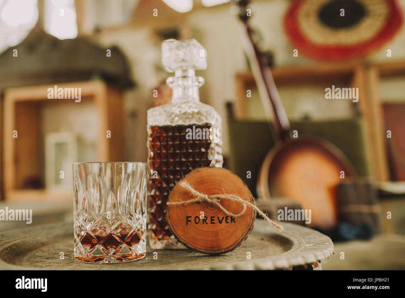Stilllife, wedding, table with whisky and sign 'Forever', symbol, nervousness, tension, - Stock Image