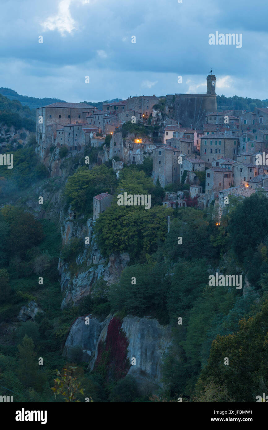 Village of Sorano at dawn. Sorano, Grosseto province, Tuscany, Italy, Europe - Stock Image