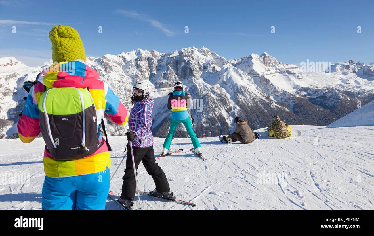 a view of a group of skiers in the Folgarida ski resort with Brenta Group in the background, Trento province, Trentino Stock Photo