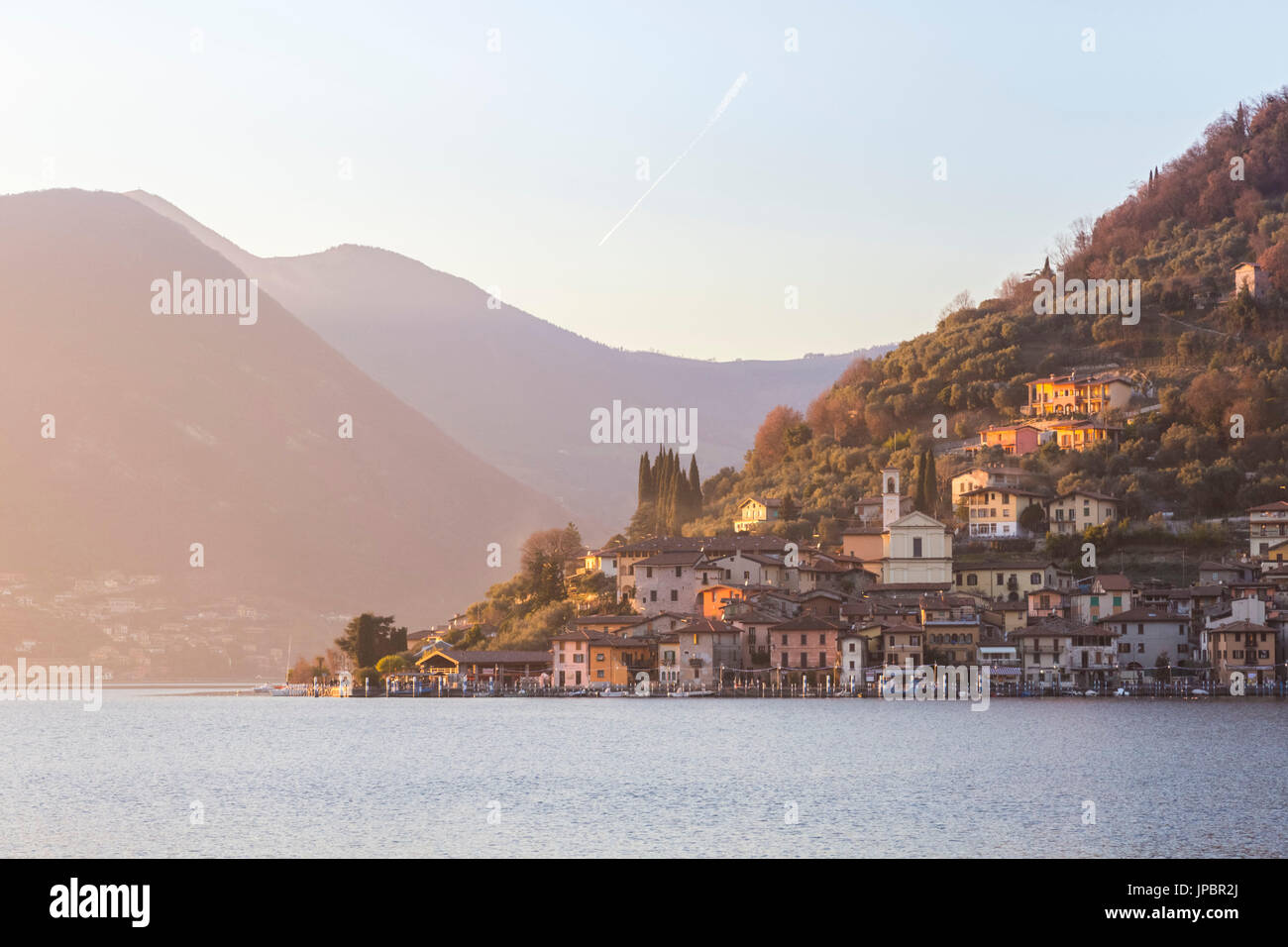 The town of Peschiera Maraglio during a winter sunset, Brescia Province, Iseo Lake, Lombardy, Italy. Stock Photo