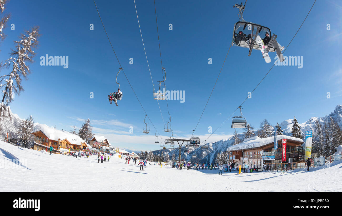 a fisheyed view of the Folgarida ski resort with a lot of tourists on the slopes, Trento province, Trentino Alto Adige, Italy, Europe - Stock Image