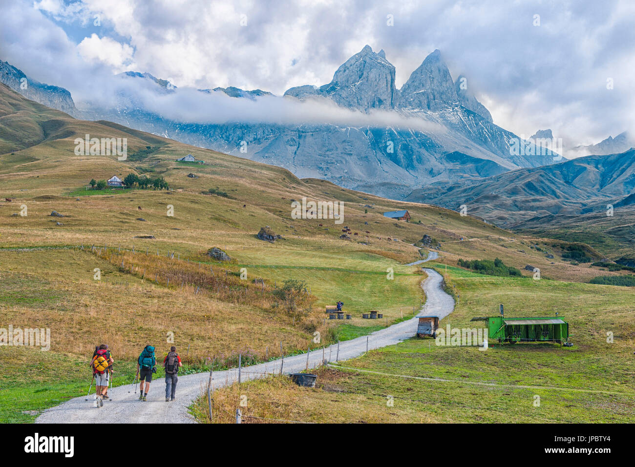 Hikers in front of the Aiguille d'Arves, Ecrins, Savoie, France Stock Photo