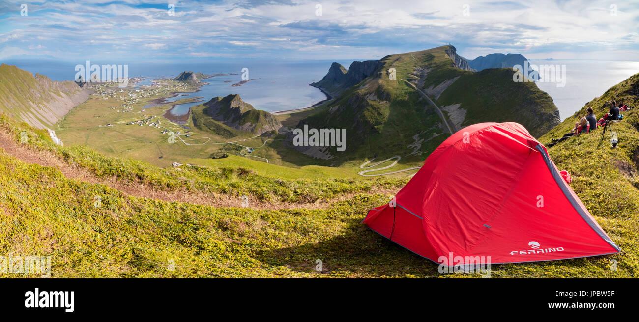 Panorama of tent on mountain ridge overlooking the sea Sorland Vaeroy Island Nordland county Lofoten archipelago Norway Europe - Stock Image