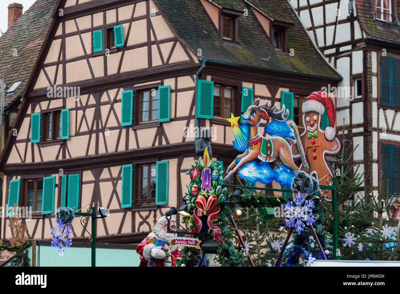 Christmas ornaments frame the typical houses of the medieval old town Colmar Haut-Rhin department Alsace France Europe - Stock Image