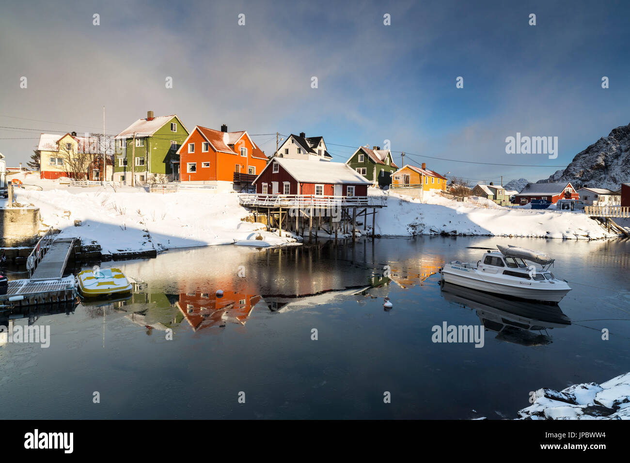 Colourful Houses in snow, Henningsvær Fishing village, Lofoten, Norway - Stock Image