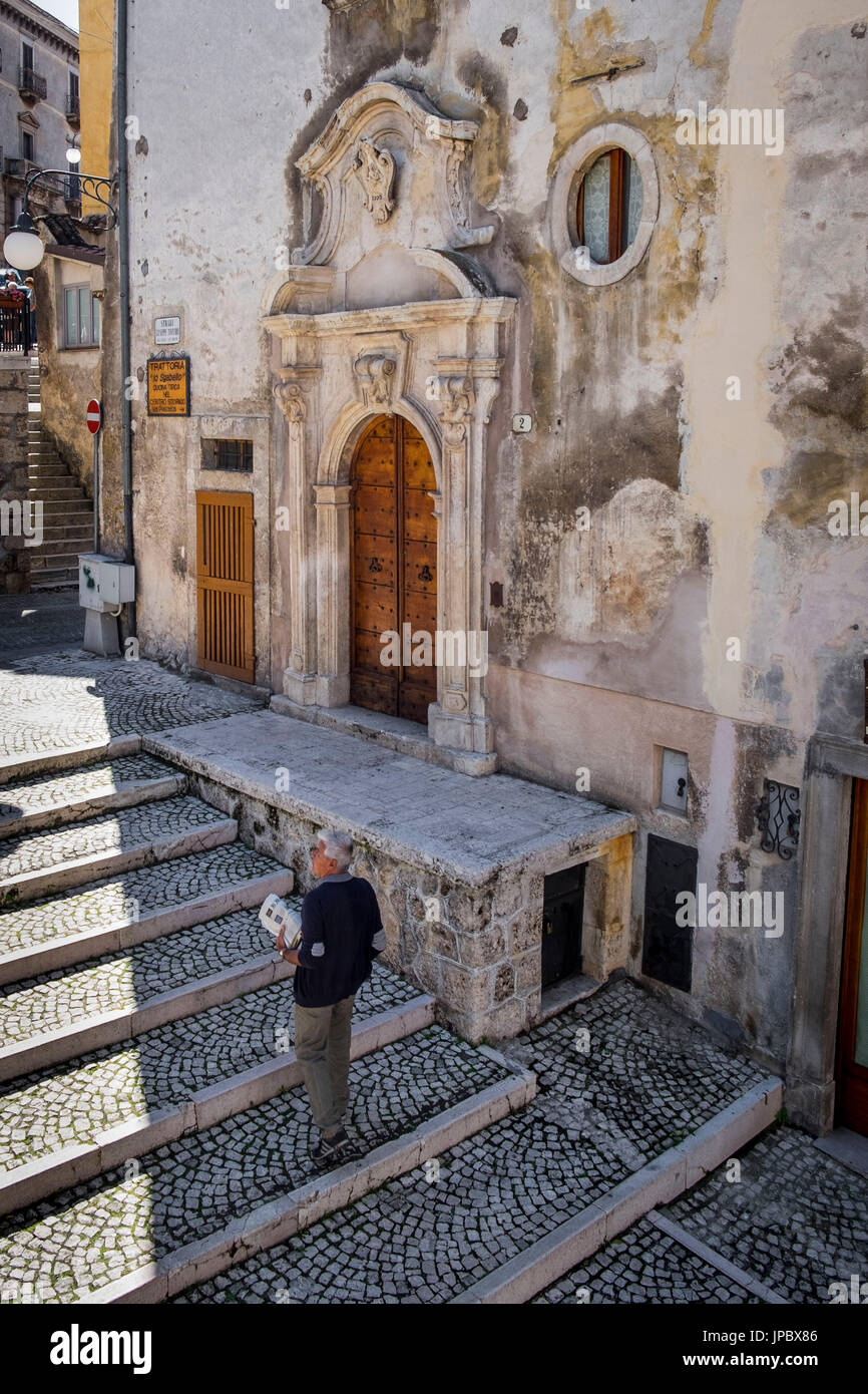 Scanno, Abruzzo, Central Italy, Europe. Passerby in the old city center. - Stock Image