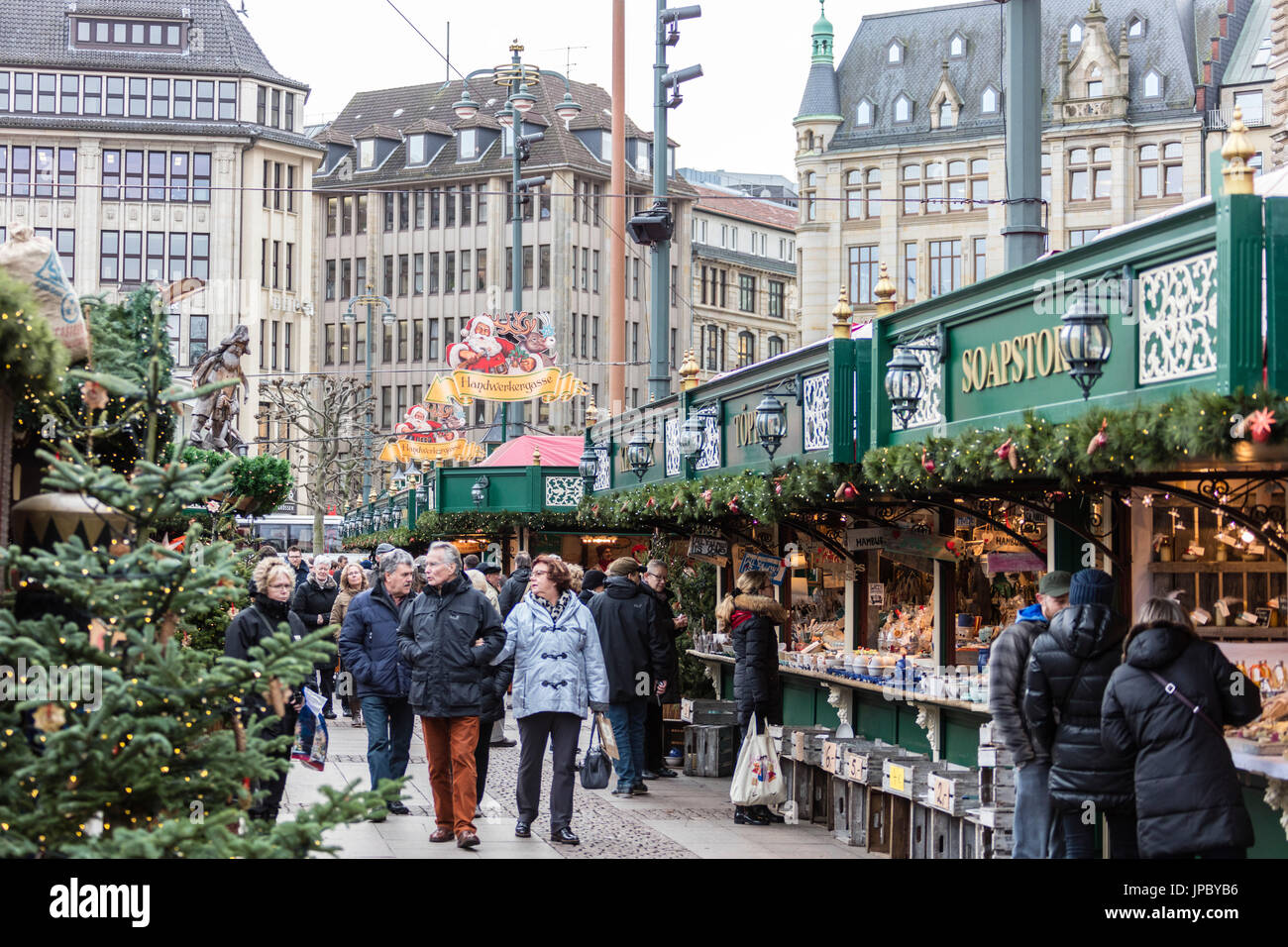 Christmas market and decorations surrounded by neoclassic architecture Rathaus square Altstadt quarter Hamburg Germany Europe - Stock Image