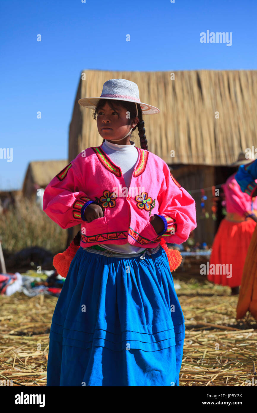 Child leaving on the Uros floating islands on Lake Titicaca, Puno, Peru - Stock Image