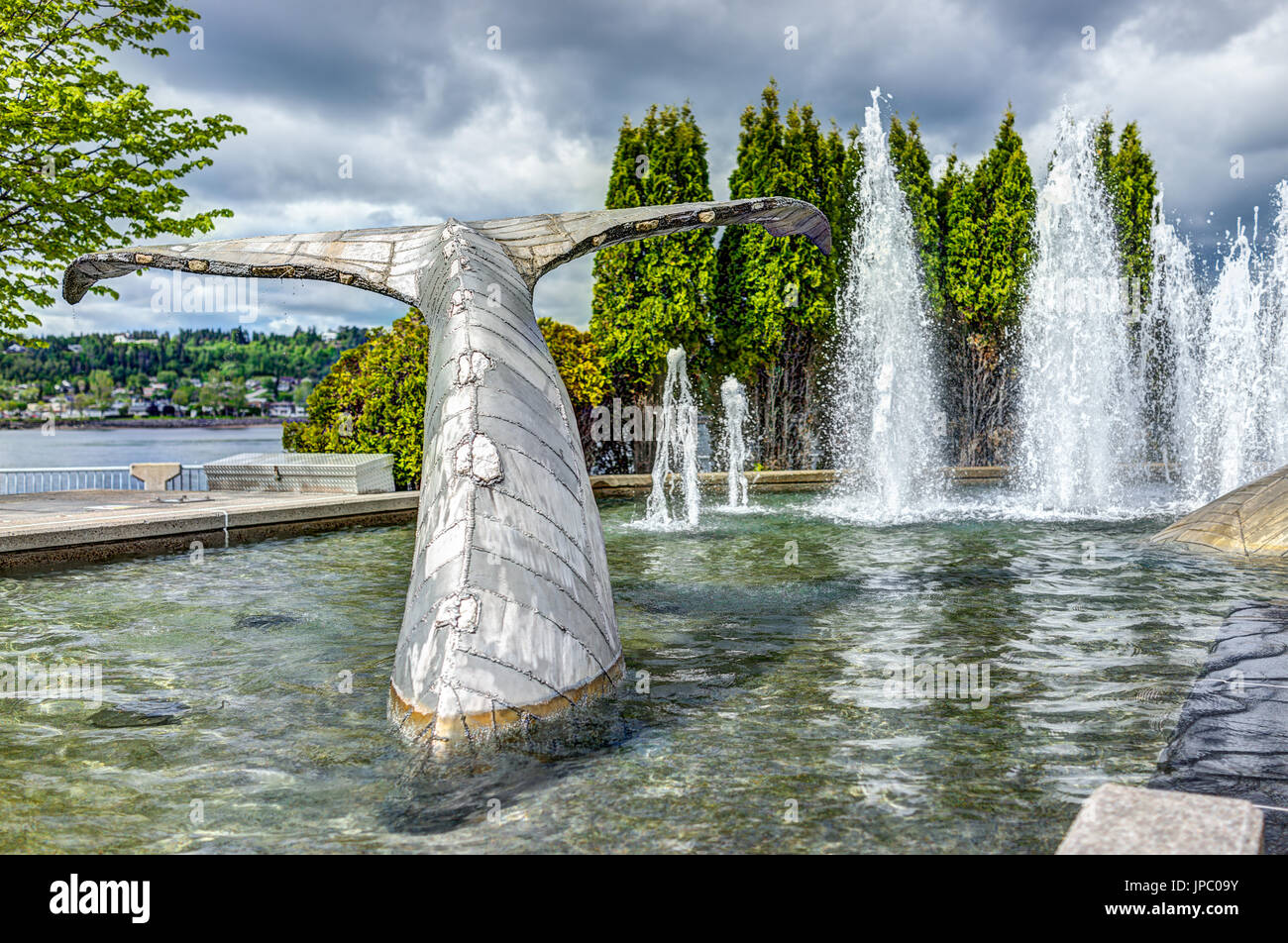 Saguenay, Canada - June 3, 2017: Closeup of by whale water fountain with tail in downtown city park in Quebec during Stock Photo