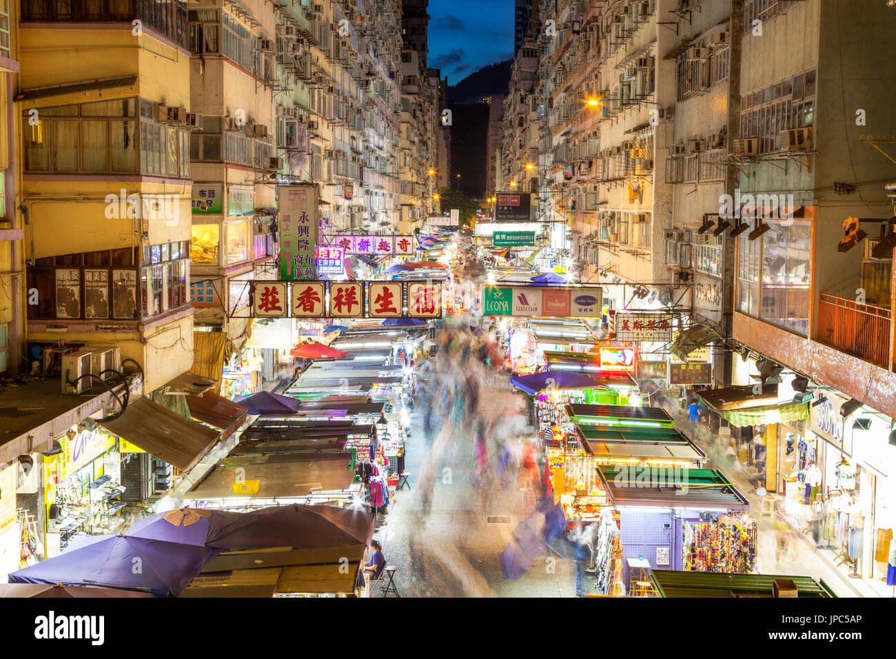 Night market in busy Fa Yuen Street in Mong Kok, Hong Kong, China. The area is popular with tourists and locals Stock Photo