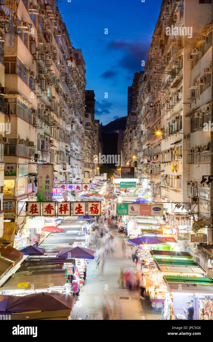 Night market in busy Fa Yuen Street in Mong Kok, Hong Kong, China. The area is popular with tourists and locals for its cheap food and fashion clothin - Stock Image