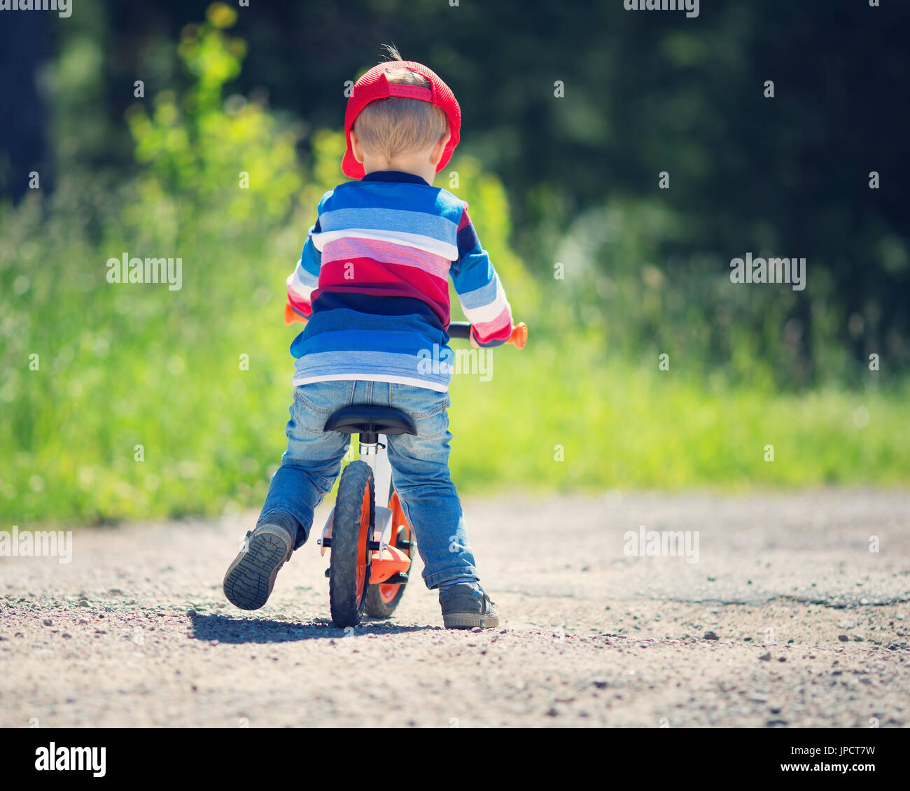 children on a bicycles - Stock Image