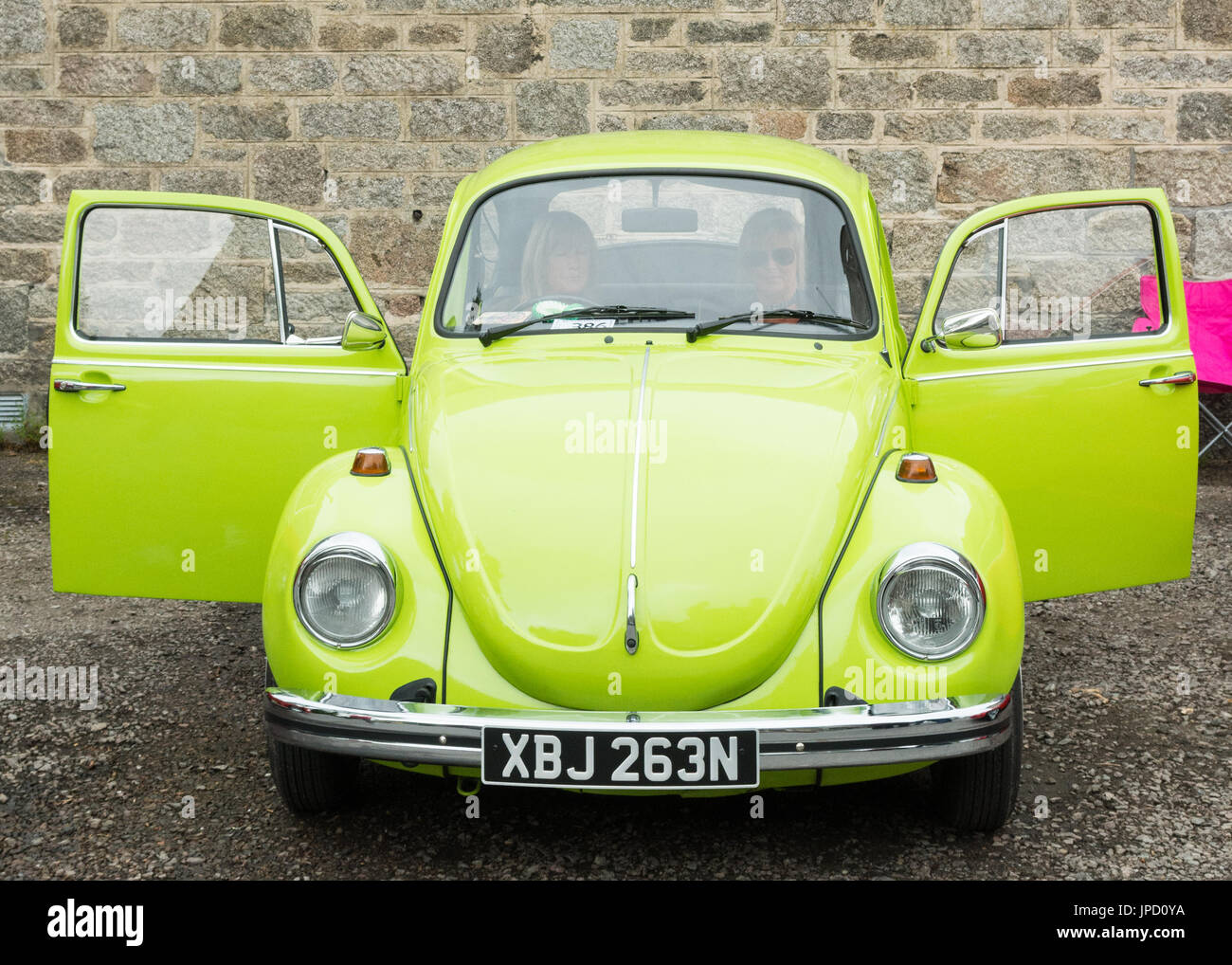 vw beetle car lime green 1974 at Motormania car show in Grantown-on-Spey, Scotland, UK - Stock Image