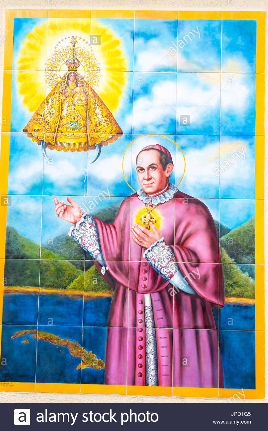 Our Lady of Charity (Spanish: Ermita de la Caridad), tile art of religious personalities decorating the exterior area of the famous landmark. - Stock Image