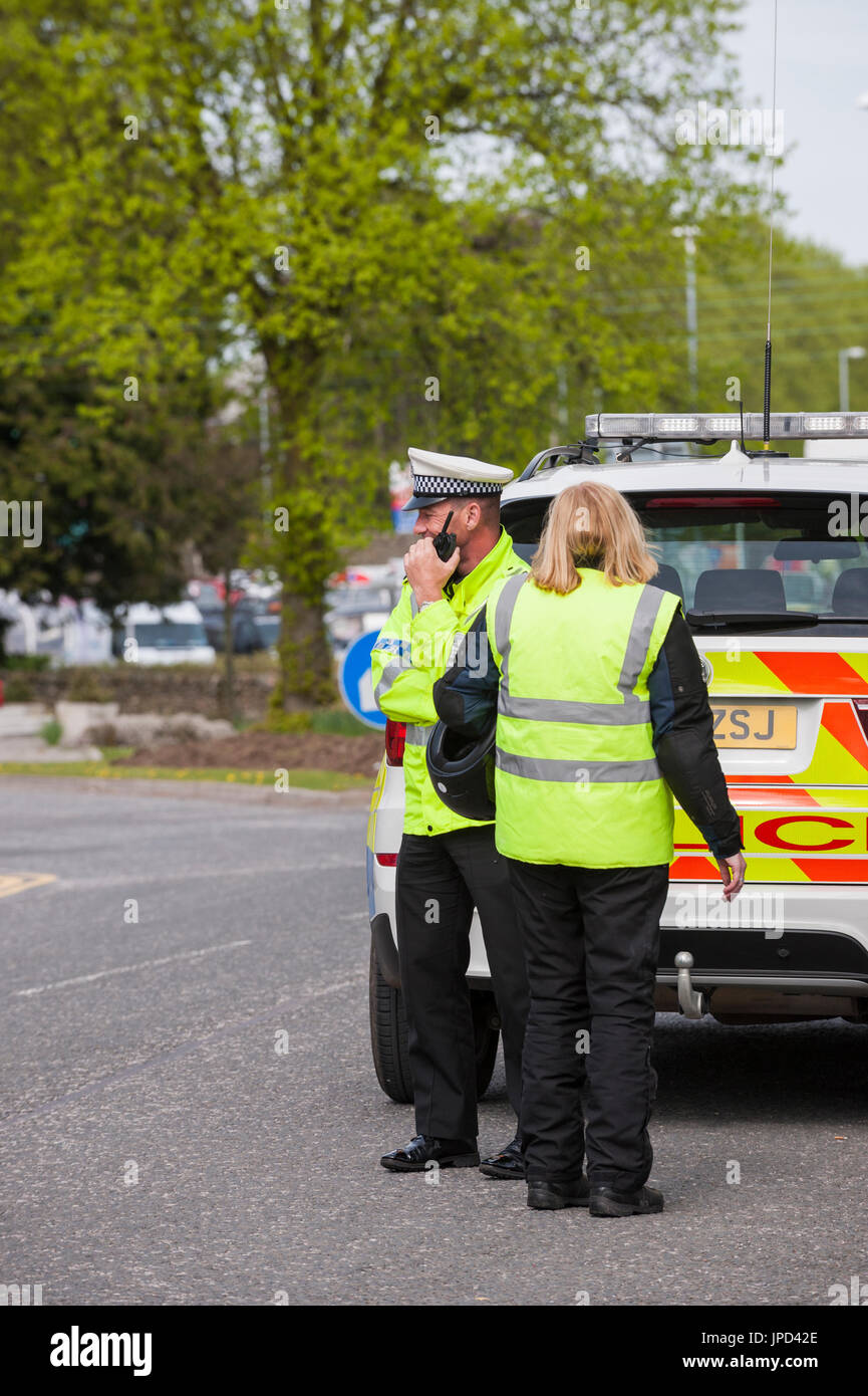 Castle Douglas, Scotland - April 25, 2011: A traffic police officer from Dumfries and Galloway constabulary is talking on his radio. - Stock Image