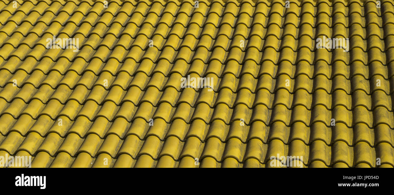 Texture of classic shingles: repeated pattern of tile of house top on the roof - Stock Image