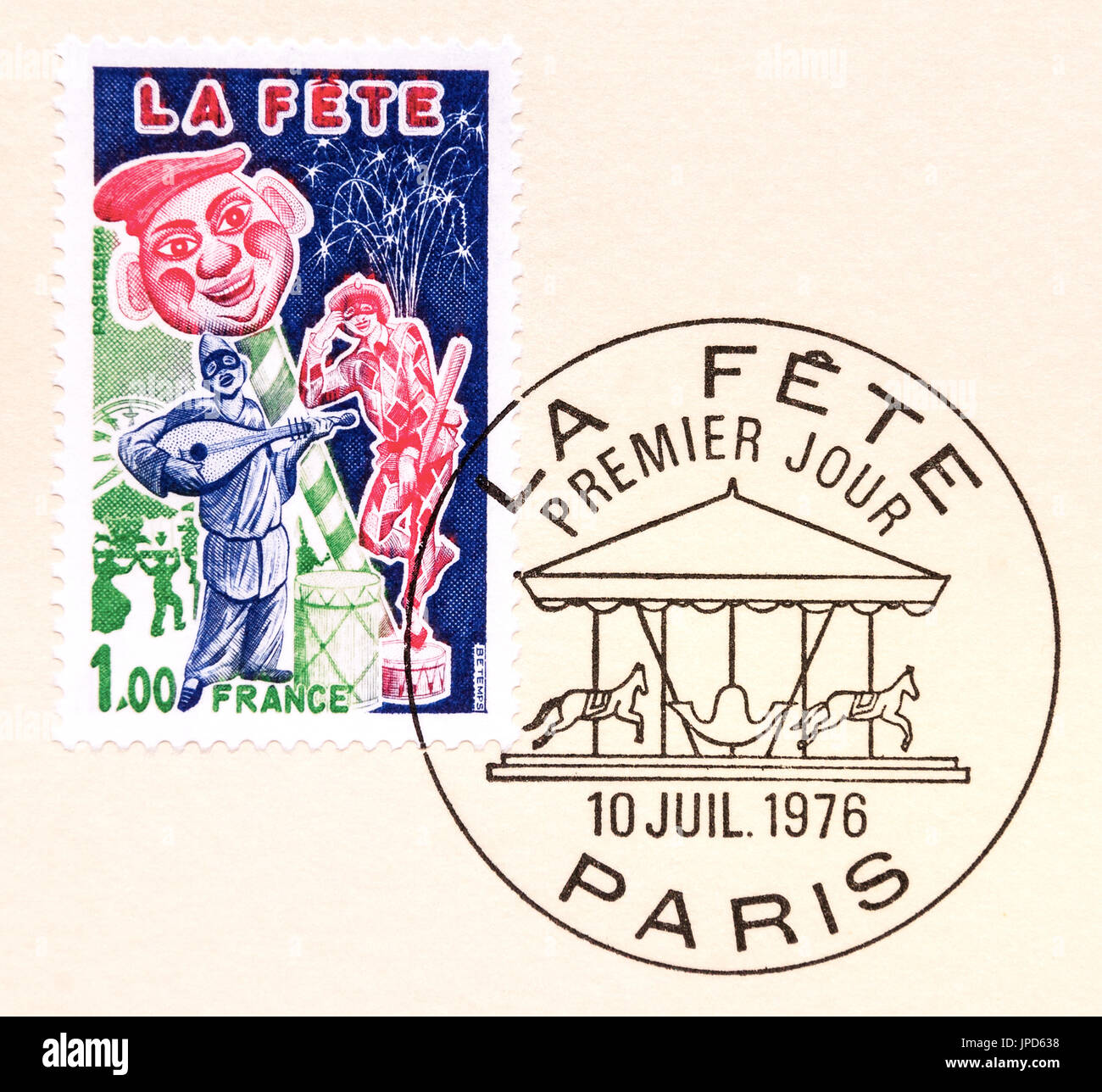 First day postmark on French stamp - La Fete. - Stock Image