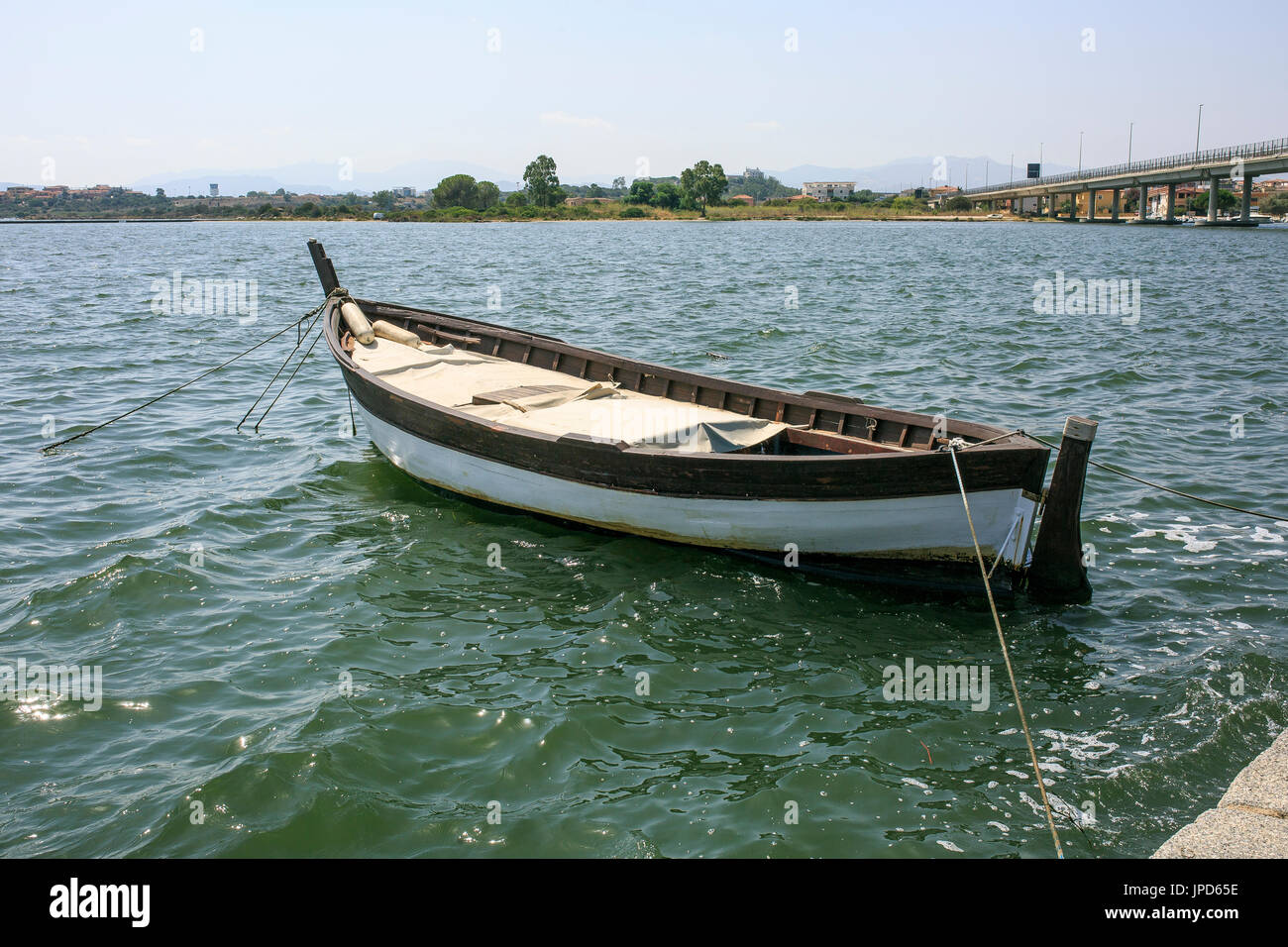 Little Wooden Boat In A River Side