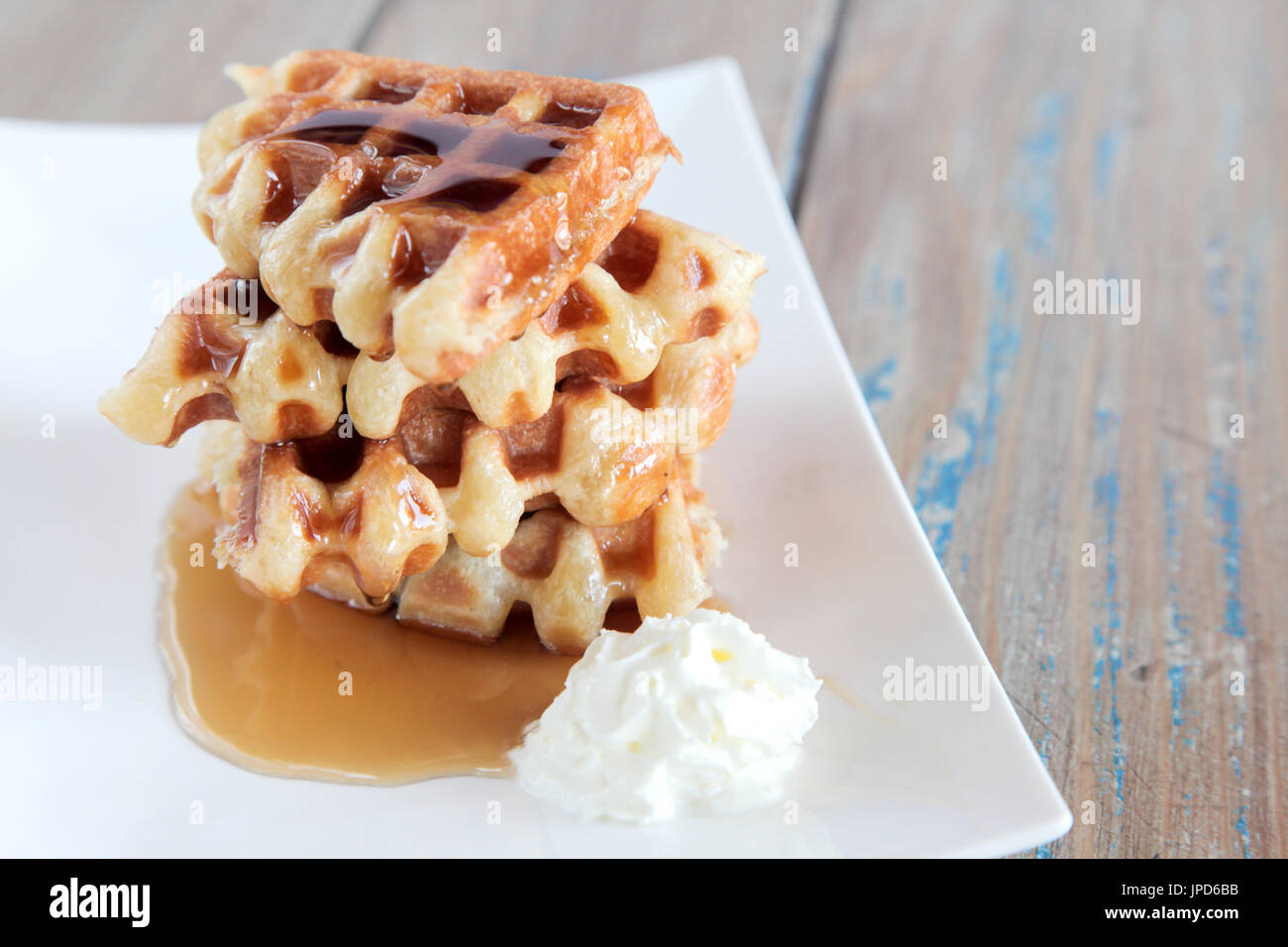 Maple syrup waffle with vanilla whipped cream - Stock Image