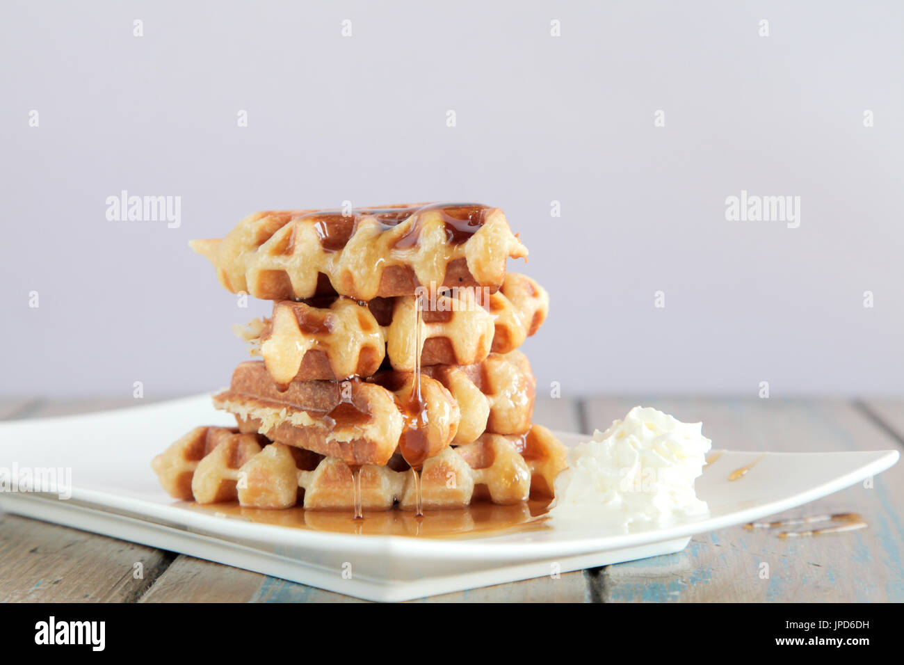 Maple syrup waffle with whipped cream - Stock Image