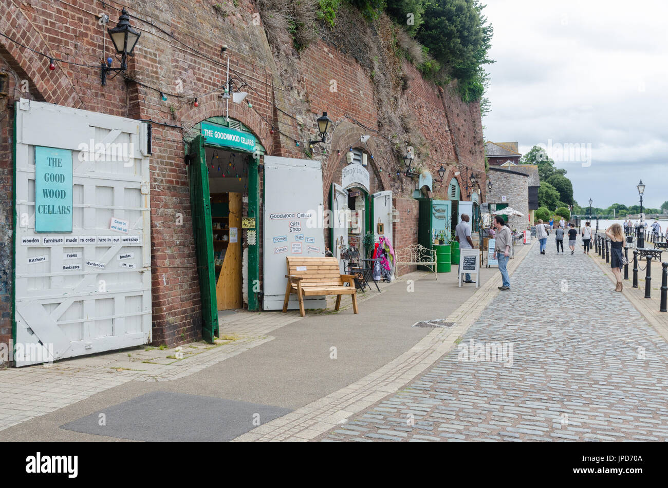 Shops and restaurants in the cellars on The Quay on the bank of the River Exe in Exeter, Devon Stock Photo