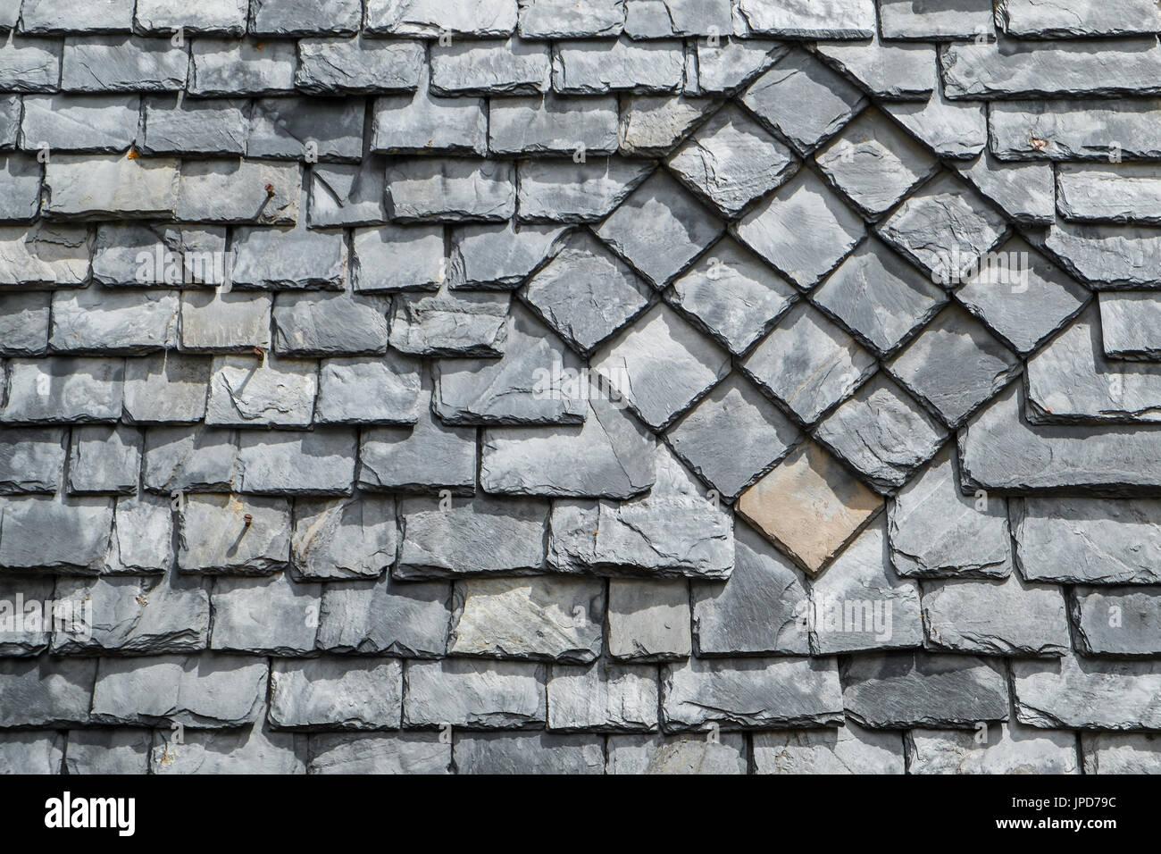 Decorative pattern on slated roof, Laruns, France. - Stock Image