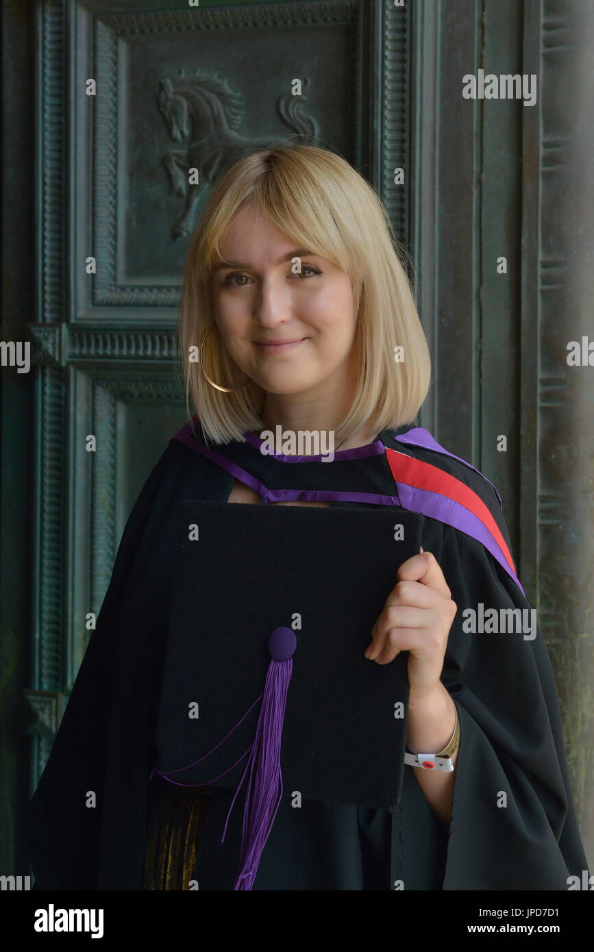 A female graduate in her academic gown. UK - Stock Image