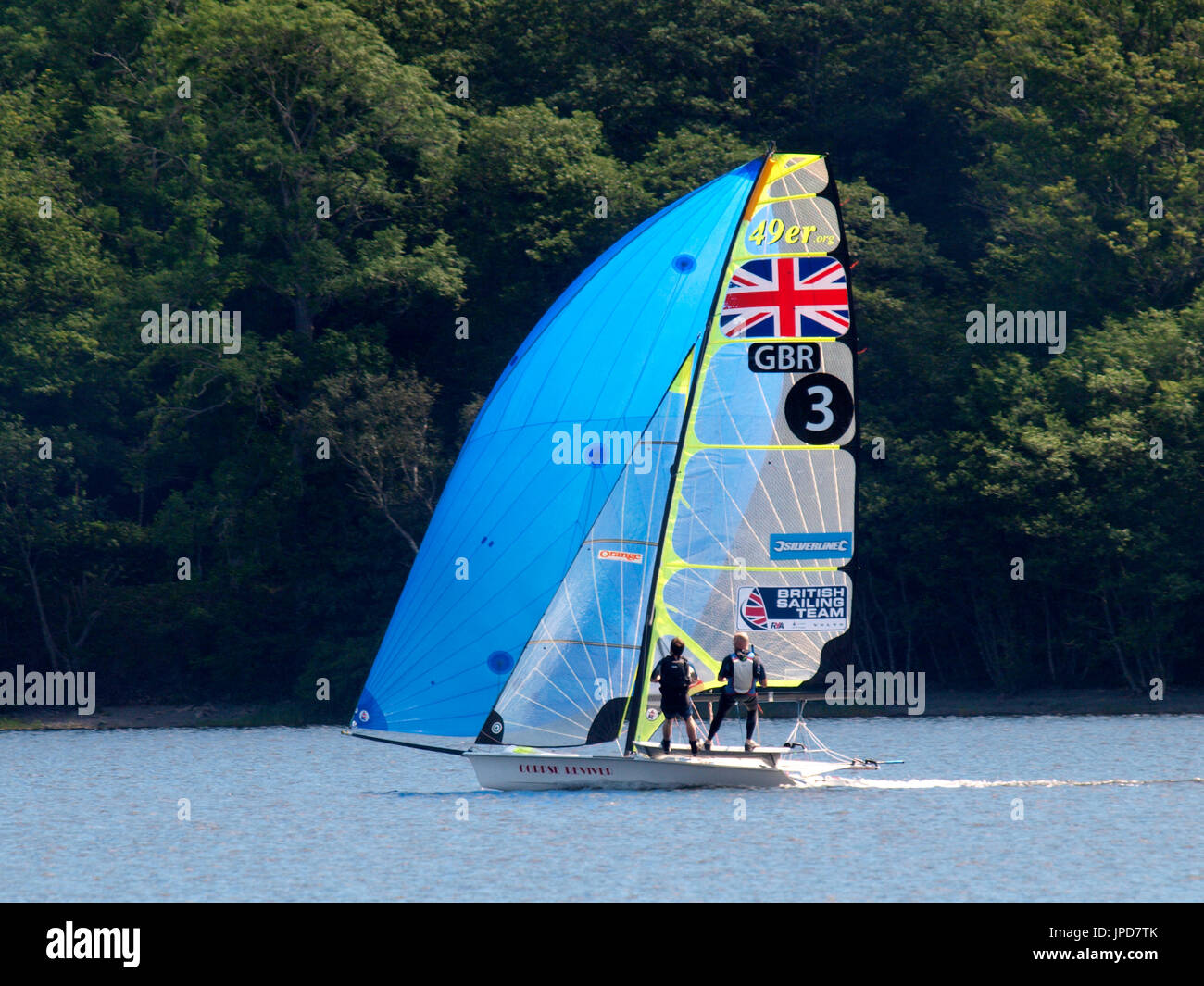 Sport sailors sailing dinghy on Coniston Water, The Lake District, Cumbria, UK - Stock Image
