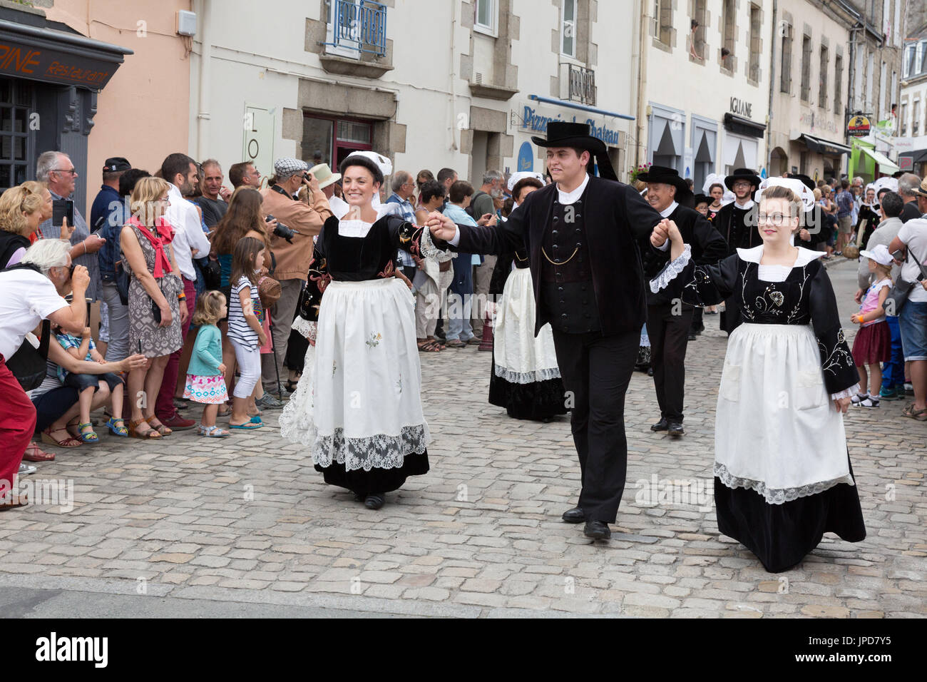 Brittany France - adults in traditional costume parading in the streets of Pont l'Abbe for the Fete des Brodeuses, Brittany France Europe - Stock Image
