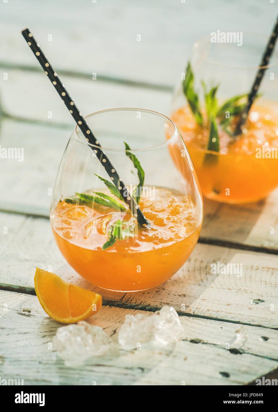 Refreshing cold alcoholic summer citrus cocktail with orange - Stock Image