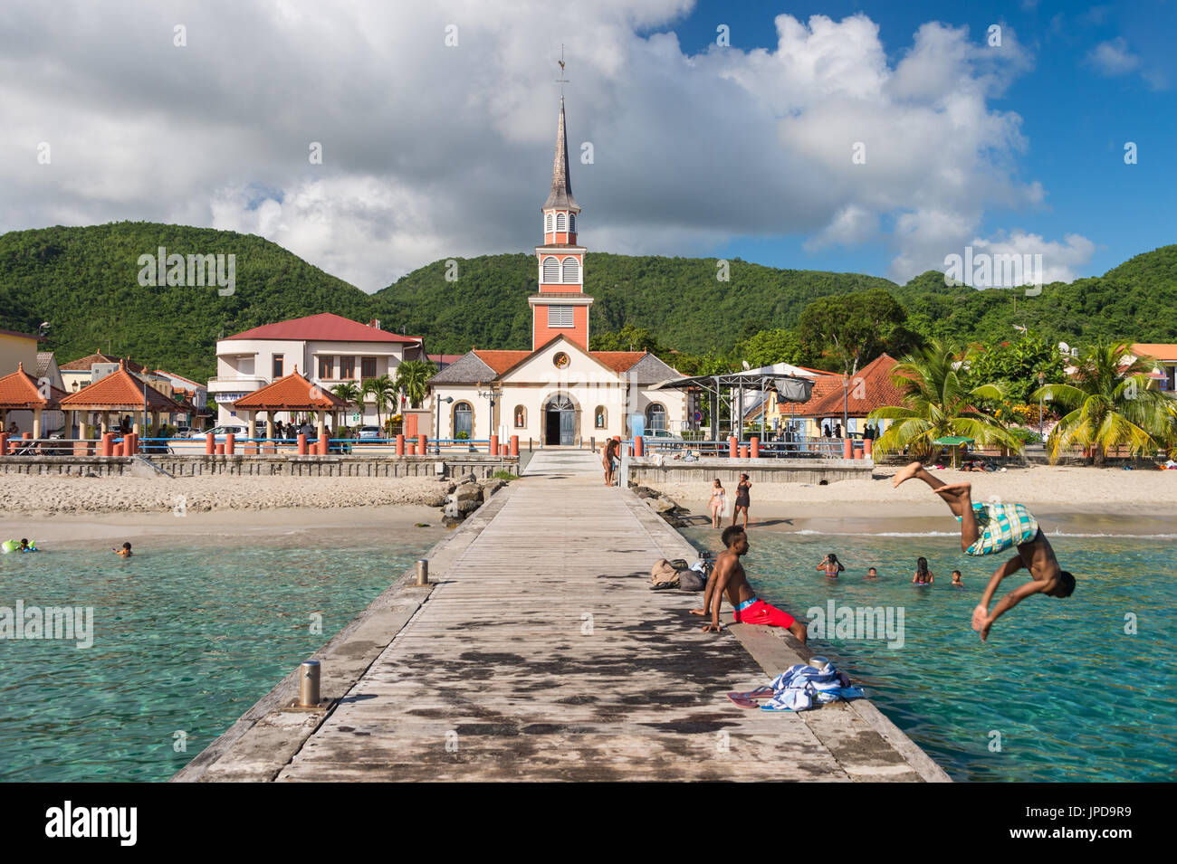 Petite Anse d'Arlet village, with Saint Henri Church and pontoon, in Martinique - Stock Image