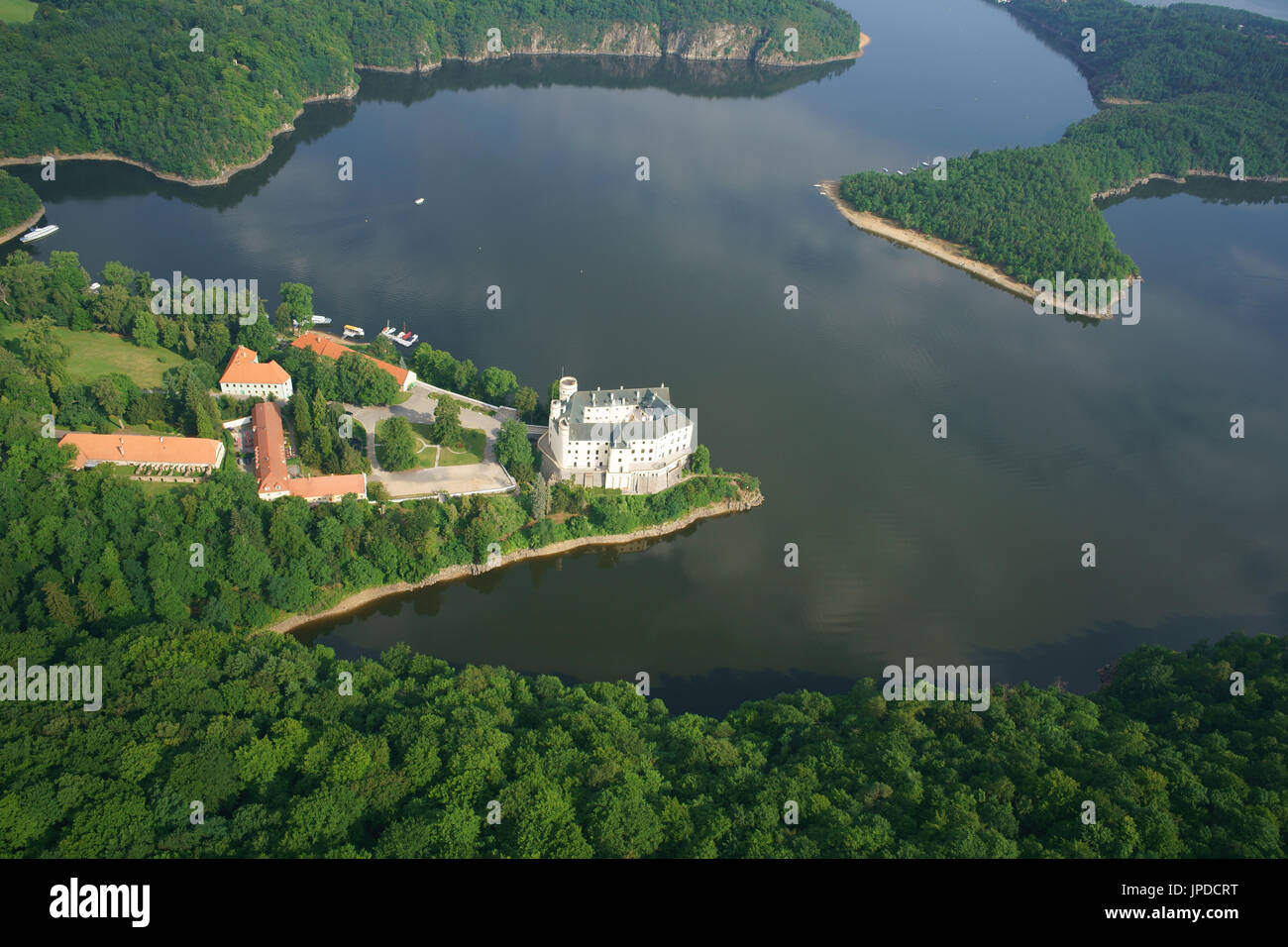 CASTLE IN THE VLTAVA VALLEY, AT LAKE ORLIK (aerial view). Orlik Castle, Bohemia, Czech Republic. - Stock Image