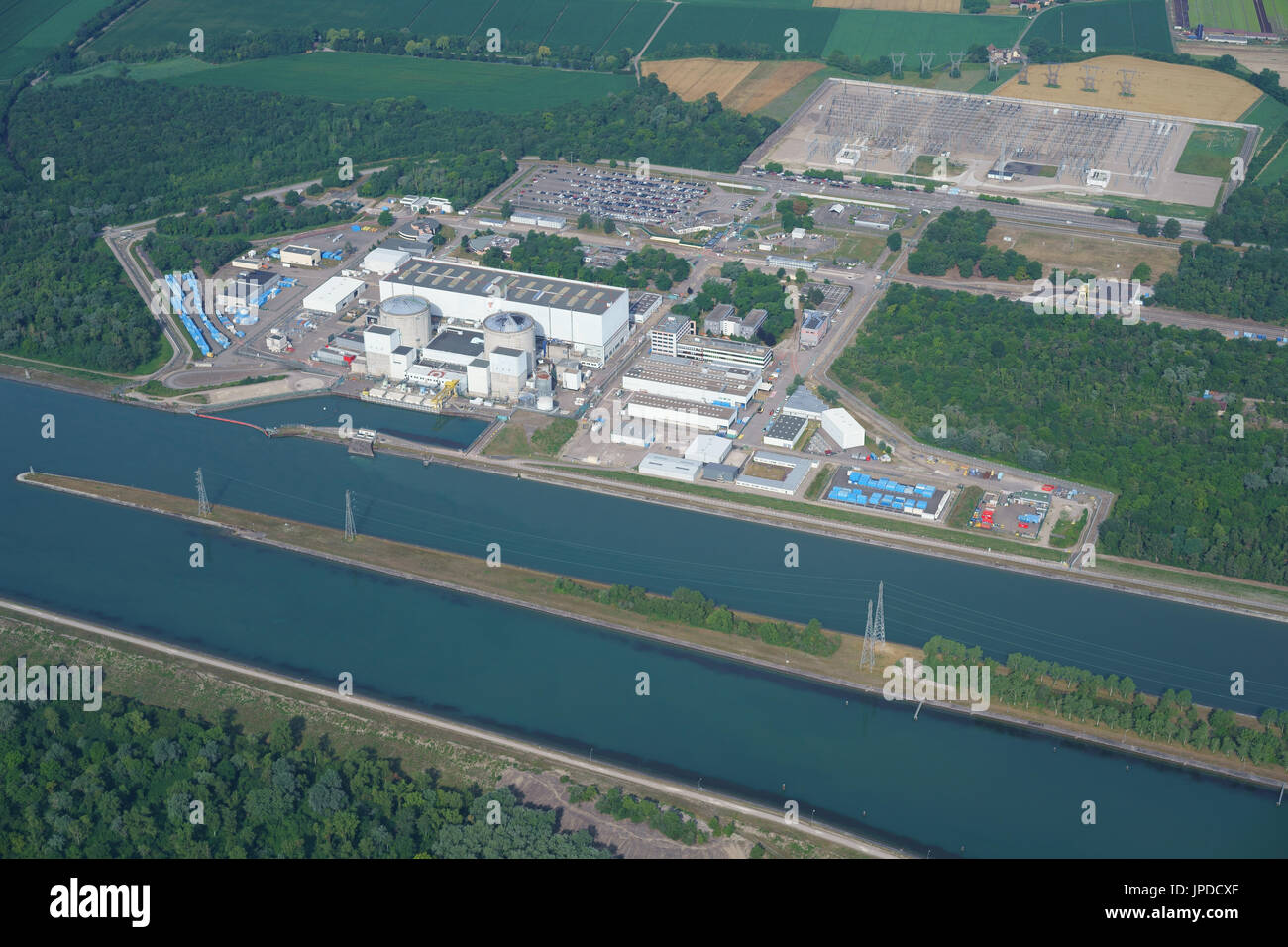 FESSENHEIM NUCLEAR POWER PLANT ALONGSIDE THE GRAND CANAL D'ALSACE (aerial view). Haut-Rhin, Alsace, Grand Est, France. - Stock Image