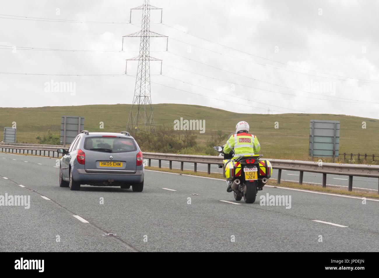 blood courier - uk motorway - Stock Image