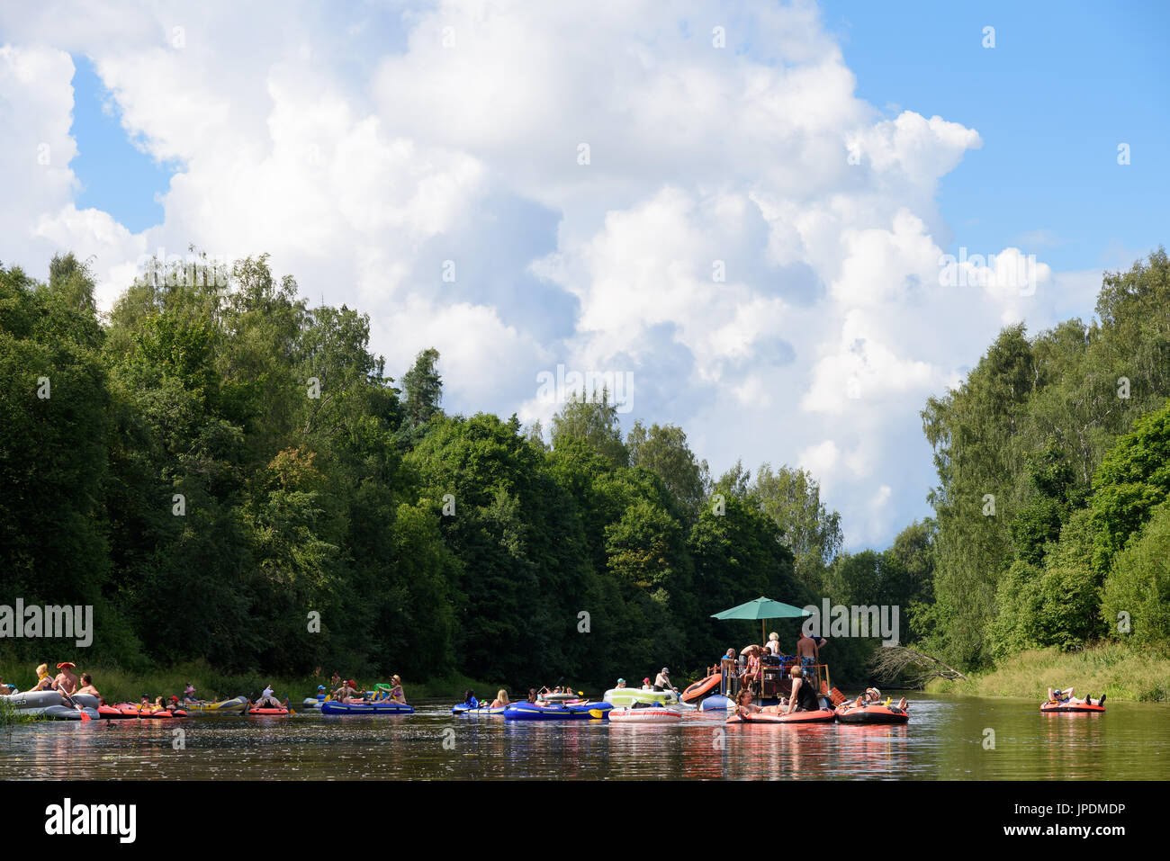 Helsinki, Finland – July 30, 2016: Unidentified people drafting and tubing in Vantaanjoki river on rubber dinghies, rafts and other inflatable floatin - Stock Image