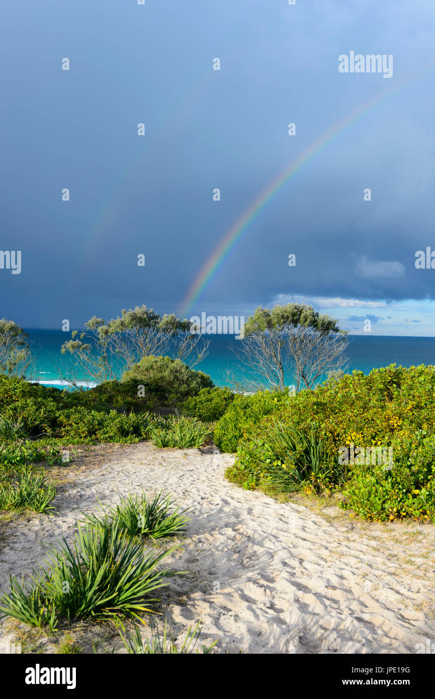 Rainbow and stormy skies over Seven Mile Beach, Forster, New South Wales, NSW, Australia Stock Photo