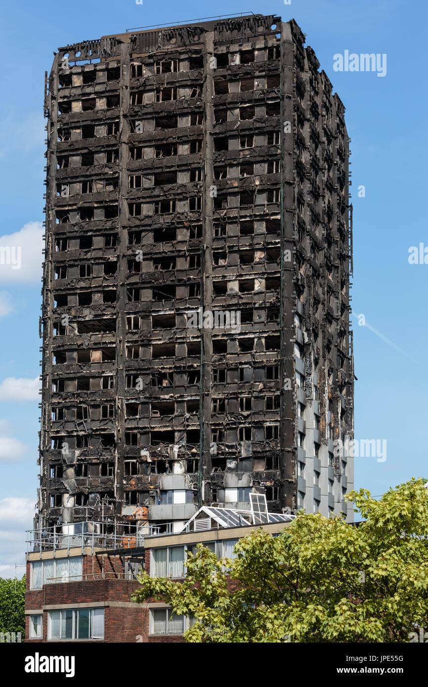 The charred remains of Grenfell Tower, a residential tower block in London. At least 80 people died following a horrific fire on 14th June 2017. - Stock Image