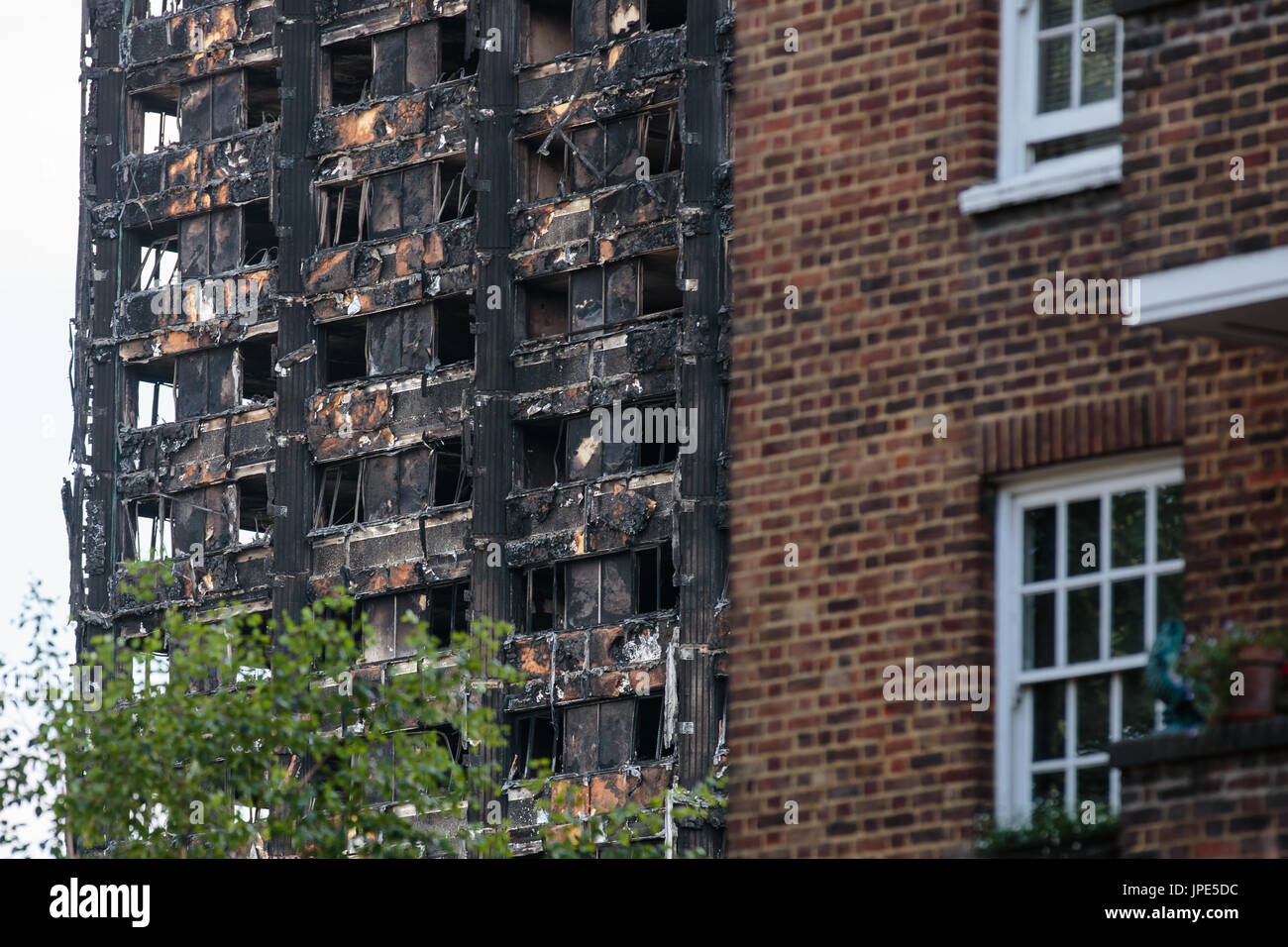 Close up view of the remains of Grenfell Tower, a residential  block of flats. At least 80 people died following a horrific fire on 14th June 2017. - Stock Image